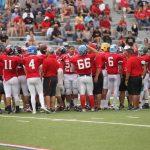 Red team huddled